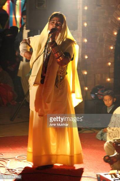 sindhi singer singing and dancers are performing - sindhi culture stock photos and pictures