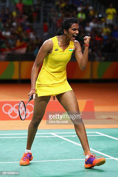 Sindhu Pusarla of India celebrates a point against Carolina Marin of Spain during the Women's Singles Gold Medal Match on Day 14 of the Rio 2016...