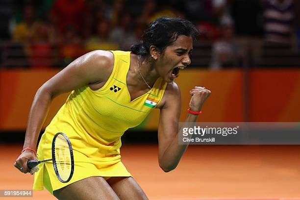 Sindhu Pusarla of India celebrates taking the first set against Carolina Marin of Spain during the Women's Singles Gold Medal Match on Day 14 of the...
