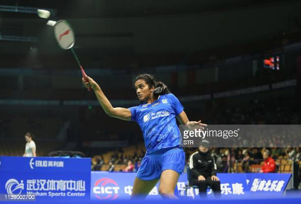 Sindhu Pusarla of India hits a return against Sayaka Takahashi of Japan during their women's singles first round match at the 2019 Badminton Asia...