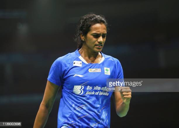 Sindhu Pusarla of India reacts during her women's singles first round match against Sayaka Takahashi of Japan at the 2019 Badminton Asia...