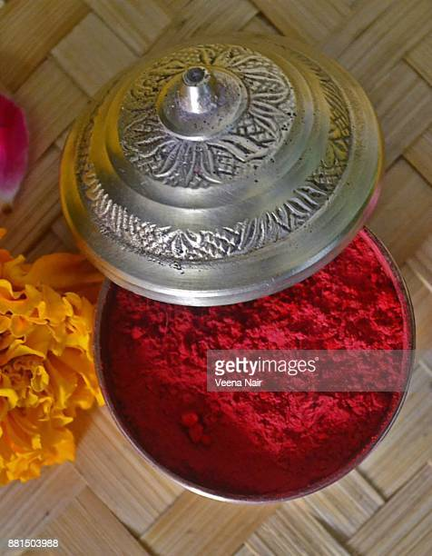 Sindoor/Vermilion/Kumkum in a vintage brass container with marigold flower