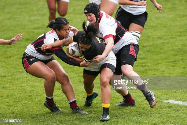 Sinead RyderTo'ala of Wellington is tackled by Amy Robertshaw and Florida Fatanitavake during the Farah Cup SemiFinal match between Wellington and...