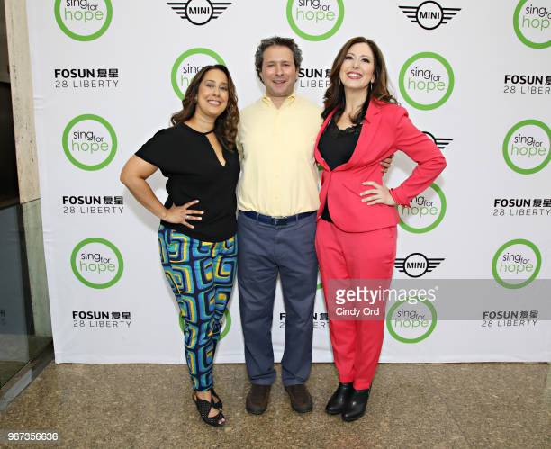 Sing For Hope cofounders Monica Yunus and Camille Zamora pose for a photo with Lee Nadler Marketing Communications Launch Manager MINI USA as The...