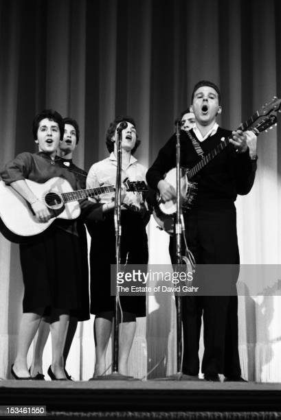 Sing Out music editor and folk musician Jerry Silverman performs with his ensemble the Harvesters at a Sing Outsponsored hootenanny at Carnegie Hall...