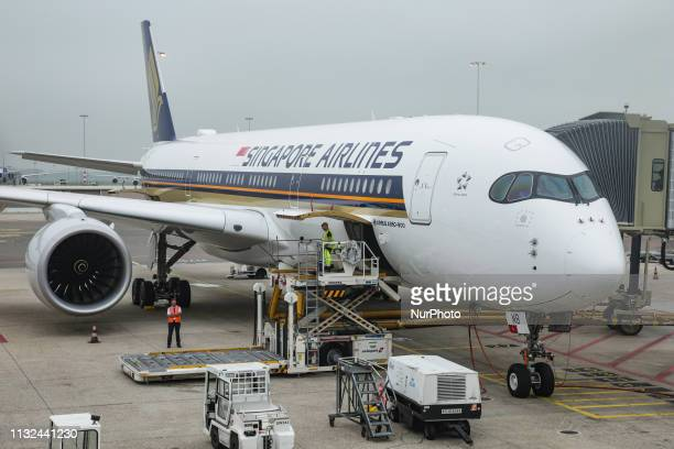 Singapore Airlines Airbus A350900 with registration 9VSMB getting loaded for departure as seen from the airport terminal in Amsterdam Schiphol...