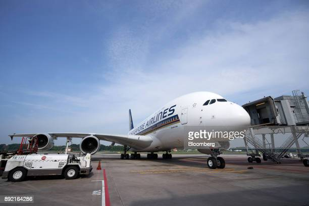 A Singapore Airlines Ltd Airbus SE A380 aircraft with refitted cabins arrives at Changi Airport in Singapore on Thursday Dec 14 2017 In the battle to...