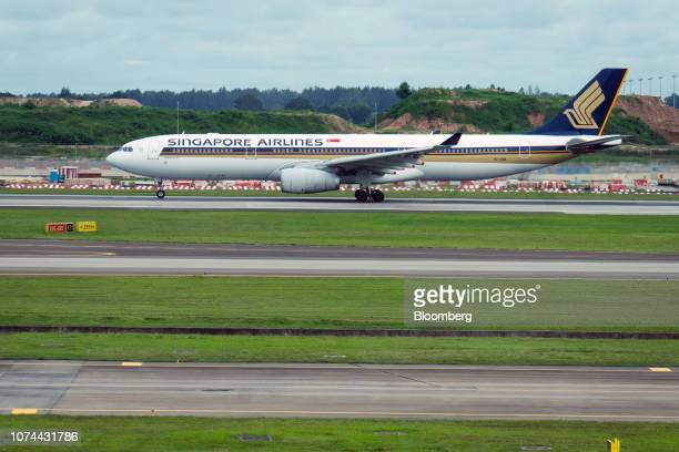 A Singapore Airlines Ltd aircraft prepares to take off at Changi Airport in Singapore on Thursday Dec 13 2018 Singapore'sChangiAirport...