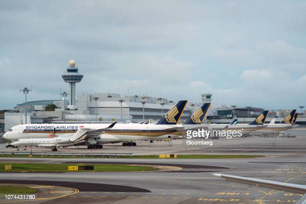 Singapore Airlines Ltd aircraft stand on the tarmac at Changi Airport in Singapore on Thursday Dec 13 2018 Singapore'sChangiAirport...