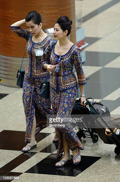 Singapore Airlines Ltd flight staff walk through Changi Airport in Singapore on Sunday July 25 2010 Singapore Airlines Ltd the world's secondlargest...