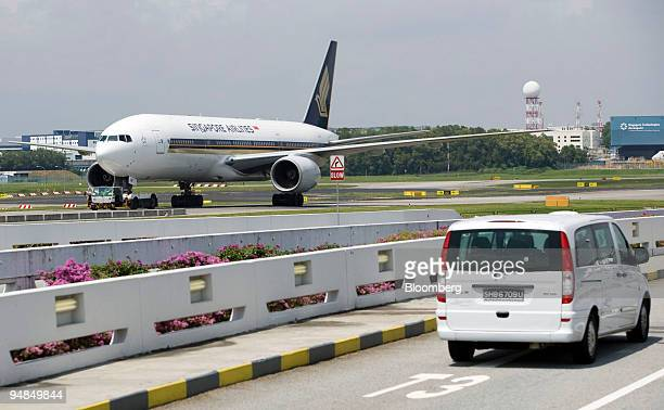 Singapore Airlines Ltd jet is towed to the runway at Changi airport in Singapore on Thursday Nov 6 2008 Singapore Airlines Ltd Asia's most profitable...