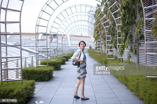 Singapore Asian Portrait a women visit a public garden