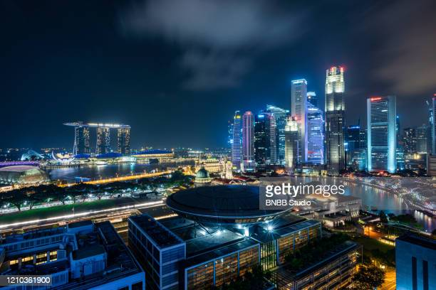 singapore business district and city skyline at night - studio city stock pictures, royalty-free photos & images