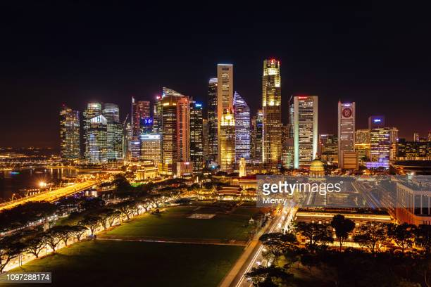 singapore business district skyline at night - marina bay sands stock photos and pictures