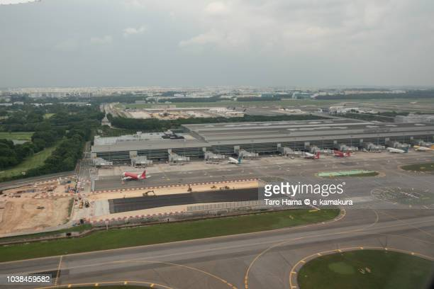 Singapore Changi Airport (SIN), daytime aerial view from airplane