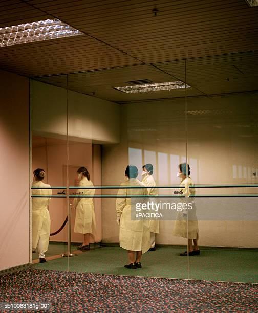 Singapore, Changi Airport, nurses behind glass wall at airport