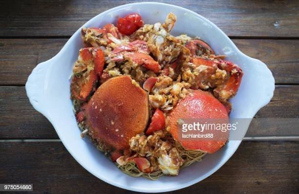 singapore chili crab on plate, singapore - chilli crab stock photos and pictures