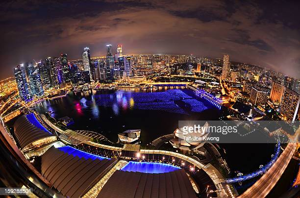 Singapore cityscape as seen from the Skypark viewing deck , Marina Bay Sands. The blue balls floating on Marina bay are the Wishing Spheres where...