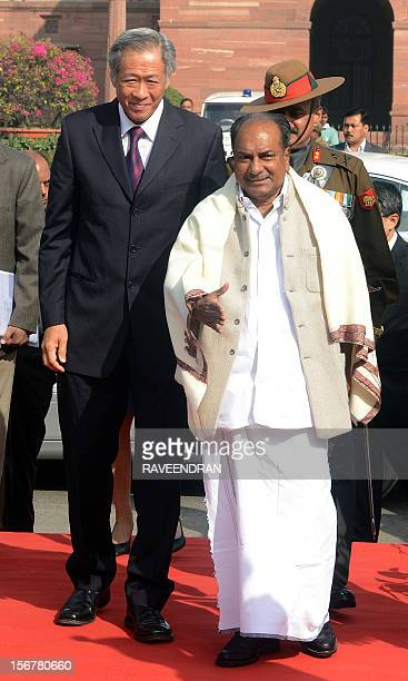 Singapore Defence Minister Ng Eng Hen walks with Indian Defence Minister AK Antony during a welcome ceremony at the Ministry of Defence in New Delhi...