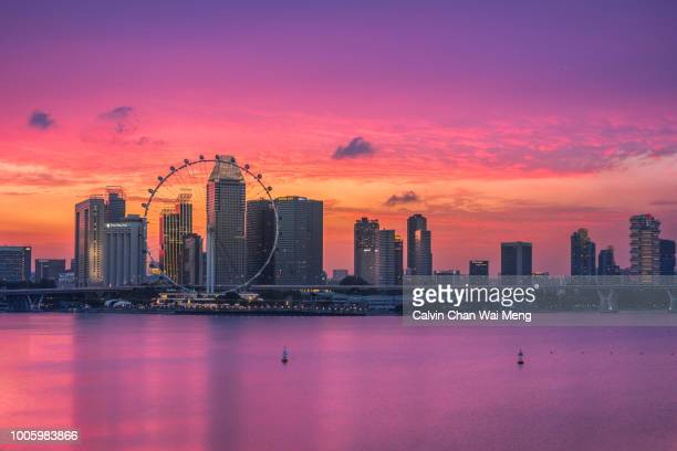 singapore dramatic cityscape and skyline - singapore flyer stock photos and pictures