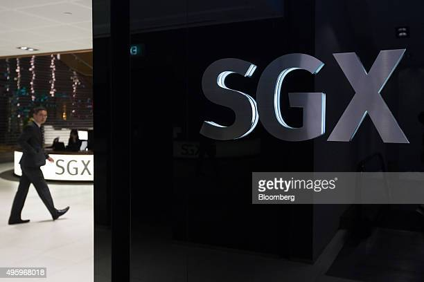 Singapore Exchange Ltd signage is displayed in the bourse's lobby in Singapore on Monday Nov 2 2015 Singapore's stock exchange is evaluating possible...
