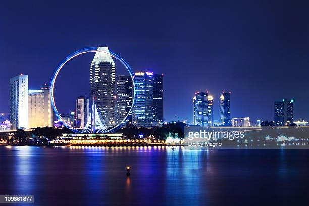 singapore flyer view at night - singapore flyer stock photos and pictures