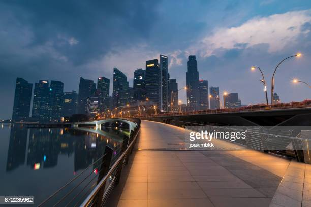 Singapore footbridge leading to business district as sunrise