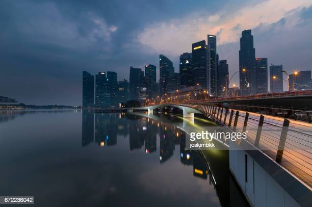 singapore footbridge leading to business district as sunrise - marina square stock photos and pictures