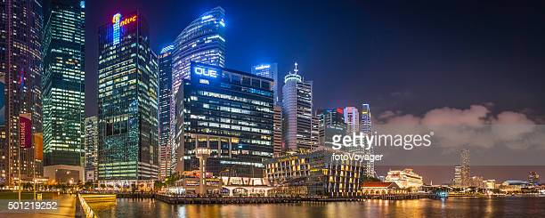 Singapore futuristic neon night CBD skyscrapers overlooking Marina Bay panorama