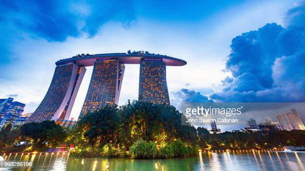singapore, gardens by the bay - marina bay sands stock photos and pictures
