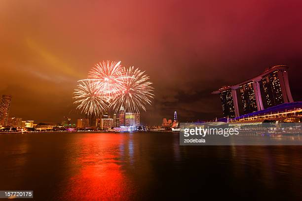 singapore marina bay by night with fireworks - national holiday stock pictures, royalty-free photos & images