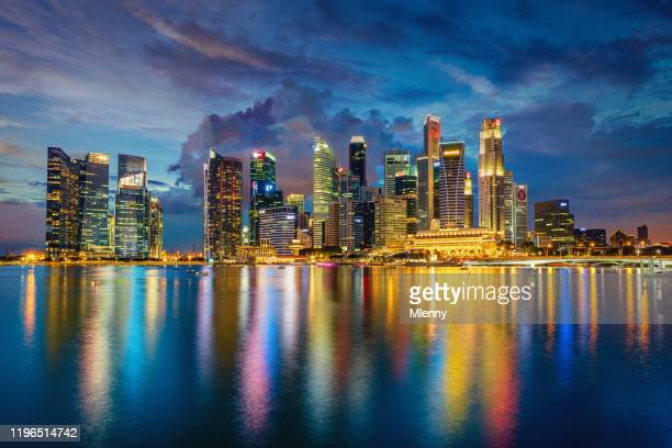 singapore marina bay cityscape panorama at dusk - association of southeast asian nations stock pictures, royalty-free photos & images