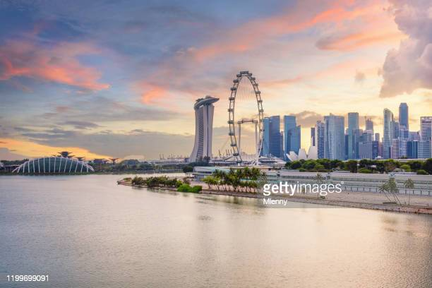 singapore marina east cityscape colorful sunset twilight - association of southeast asian nations stock pictures, royalty-free photos & images