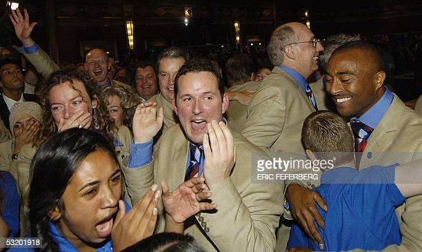 Members of the British delegation celebrate after the official announcement that London will host the 2012 Summer Olympics following the vote of the...