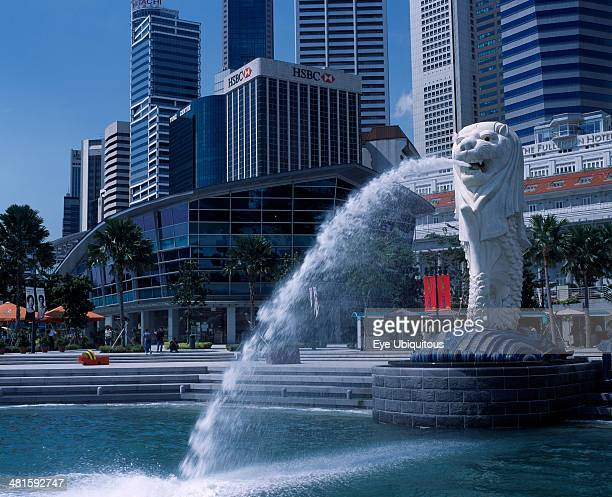 Singapore Merlion Park Merlion statue and fountain in front of the Fullerton Hotel and city buildings including HSBC Bank and Tung Centre