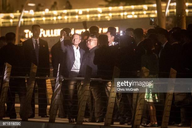 Singapore Minister for Foreign Affairs Vivian Balakrishnan takes a selfie with North Korean leader Kim Jongun walks along the Jubilee bridge during a...