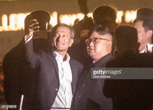 Singapore Minister for Foreign Affairs Vivian Balakrishnan takes a selfie with North Korean leader Kim Jongun walks along the Jubilee bridge during a...