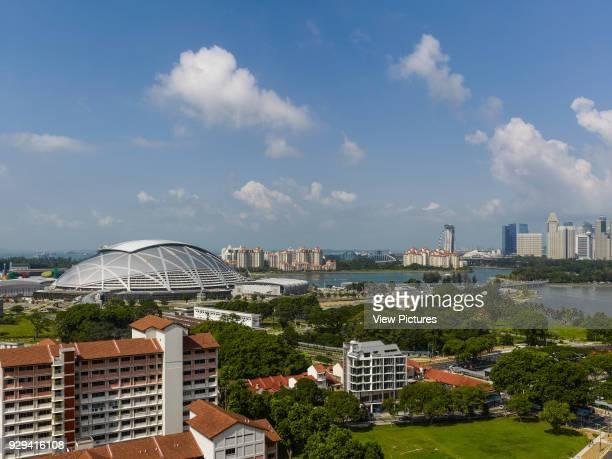 Singapore National Stadium, Singapore, Singapore. Architect: Arup Associates, 2014. General view of stadium with cityscape context.