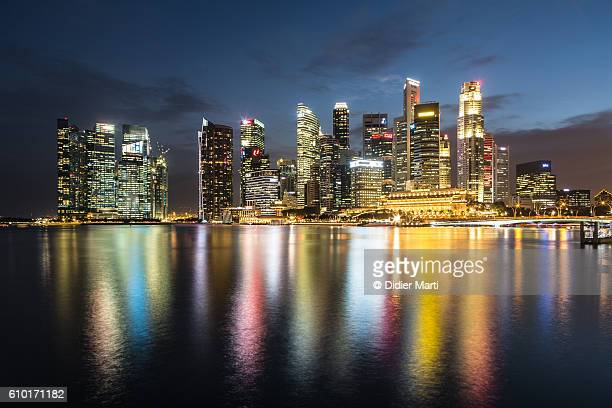 singapore night skyline - emerging markets stock photos and pictures