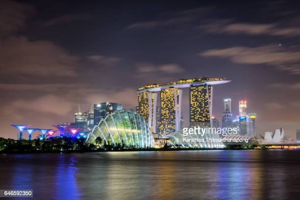 singapore panoramic night city - marina bay sands stock photos and pictures
