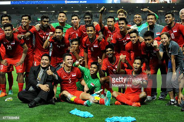 Singapore players celebrate after the 2018 FIFA World Cup Asian Qualifier second round match between Japan and Singapore at Saitama Stadium on June...
