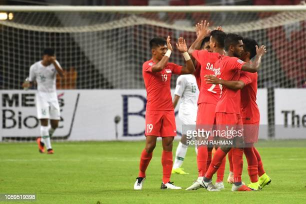 Singapore players from left Shahril Ishak, Safuwan Baharudin, Hariss Harun, and Yasir Hanapi celebrate after winning against Indonesia during the AFF...