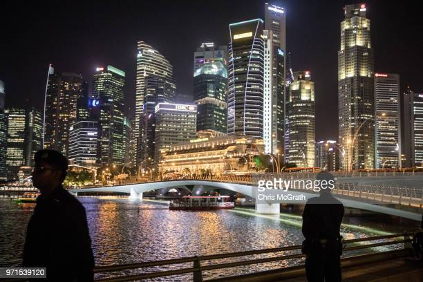 Singapore Police officers stand guard at ahead of North Korean leader Kim Jongun walk on the Jubilee bridge during a tour of some of the sights on...