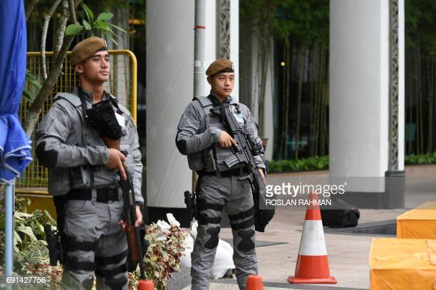 Singapore policemen from the Gurkhas contingent stand guard outside the hotel at the Institute for Strategic Studies during the ShangriLa Dialogue...