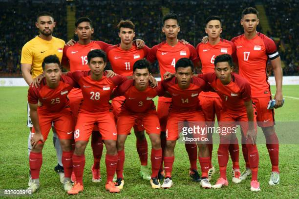 Singapore poses before kick off during the Men Fooball Group A preliminary compettion between Singapore and Malaysia at Shah Alam Stadium as part of...