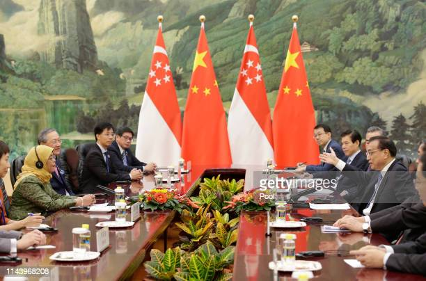 Singapore President Halimah Yacob and Chinese Premier Li Keqiang attend a meeting at the Great Hall of the People on May 15 2019 in Beijing China