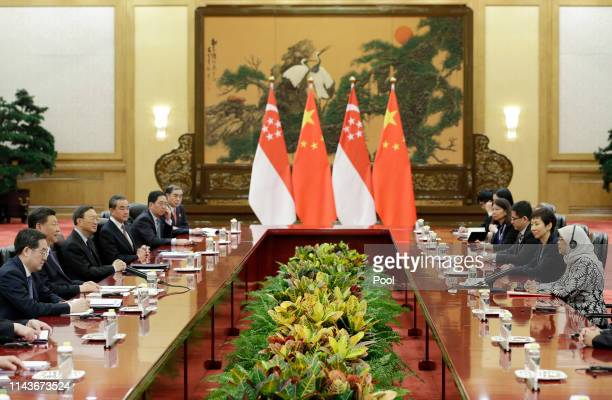 Singapore President Halimah Yacob and Chinese President Xi Jinping attend a meeting at the Great Hall of the People on May 14 2019 in Beijing China