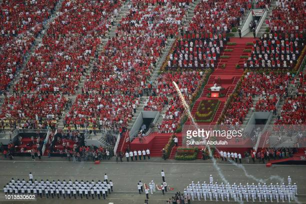 Singapore President Halimah Yacob is given a welcome ceremony during the National Day Parade at Marina Bay on August 9 2018 in Singapore