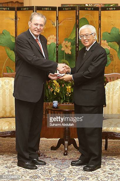Singapore President, Tony Tan Keng Yam confers the Public Service Star on President of the International Olympic Committee , Dr Jacques Rogge , to...