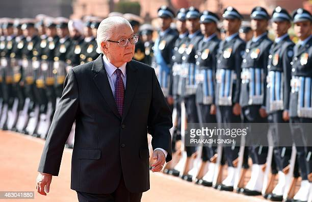 Singapore President Tony Tan Keng Yam inspects the guard of honour during a ceremonial reception at the Presidential Palace in New Delhi on February...